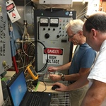 Stu Harris and Chris Smith operating the EUV Aperture Door Closer GSE