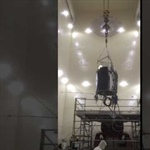 ICON being lifted onto the vibration test fixture